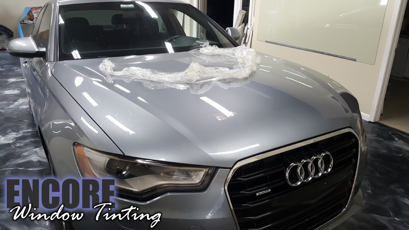 2014 Audi A6 Picture of Paint Protection film on hood during removal process