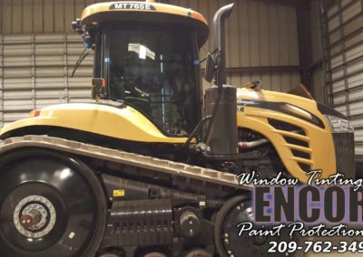 Holt CHALLENGER MT765E with enocre window tinting and paint protection film logo and phone numper